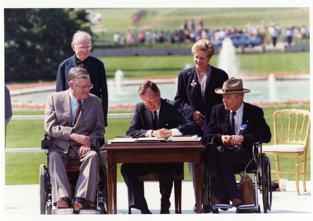 George H.W. Bush signing ADA with onlookers outside