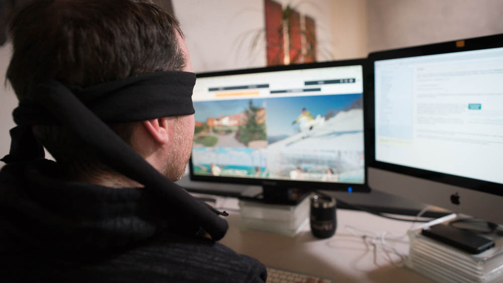 Blindfolded Man Testing Web Accessibility